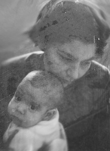My mother and me when I was ill as a baby. Her fear and sadness are written on her face.